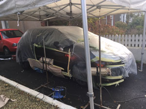 Citroen C1 Car being repaired under gazebo using standox paint repair system
